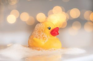 Photo of rubber duck in a bubble bath